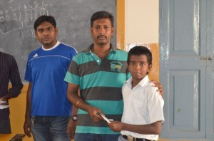 Handing Over Scholarship Amount To Student